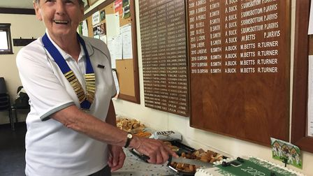 Club president Diane Bryan cuts the cake. Pictures: Courtesy of Oulton Broad Bowls Club