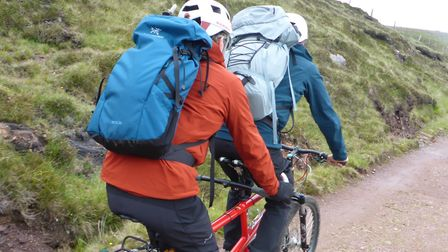 The tandem bike with Red (second) heading for the cliff edge and Am Buachaille. Picture: Nick Carter
