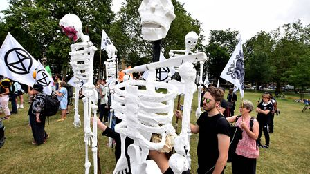 Extinction Rebellion demonstrators mass on Hackney Downs ahead of their Skeleton March to London Fie