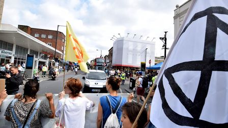 "Extinction Rebellion campaigners ""swarm"" Kingsland Road, blocking traffic for seven minute intervals"