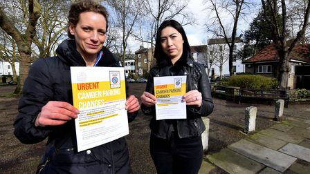 Nicola Caisley and Bee Kwan with leafets about proposed changes to Highgate's CPZ, in Pond Square Hi