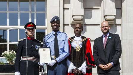 Donelle Roach presented with the deputy lieutenant's certificate at Armed Forces Day. Photo by Rich