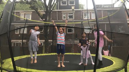 Youngsters playing on the banned trampoline in Yorkshire Grove. Picture: Annie Collinge