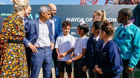 Mayor Khan speaks to youngsters who put objects representing the capital in the time capsule. Pictur