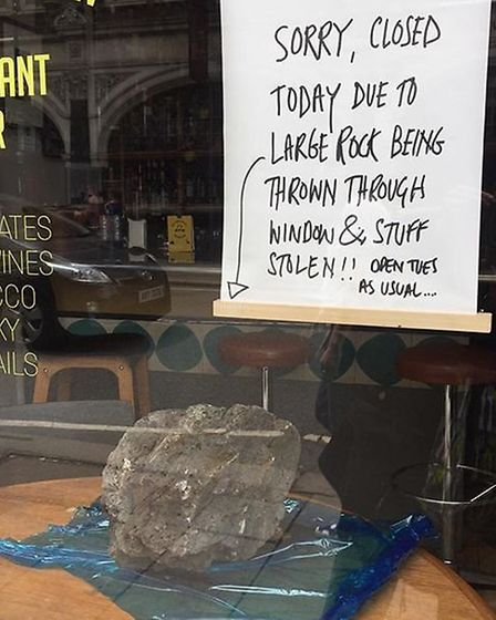 The rock on display at Irvin Bar Grill after the break-in. Picture: Irvin Bar Grill