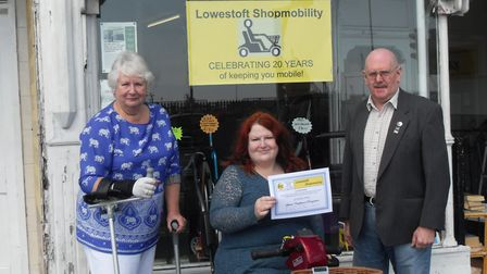 Pictured is Eddie, co-ordinator of Lowestoft Shopmobility, and Margaret Oldham, chairman, presenting
