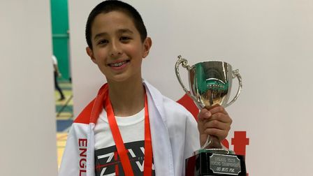 David Sosnov nabs the gold medal and the trophy in the under-13 age category at the England Youth Ch