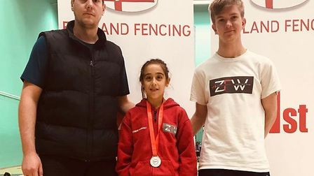 Eugenie Raimbault, pictured here with coaches Peter Barwell (blue jacket) and Edmund Howlett (ZFW t-