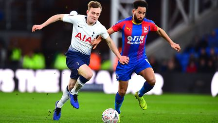 Tottenham Hotspur's Oliver Skipp (left) and Crystal Palace's Andros Townsend battle for the ball dur