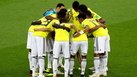Colombia players in a huddle (pic: Aaron Chown/PA).