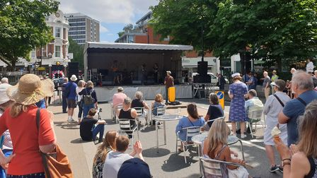 Visitors to the South End Green Festival look on as Vamila Rowe and John Etheridge play on the stage