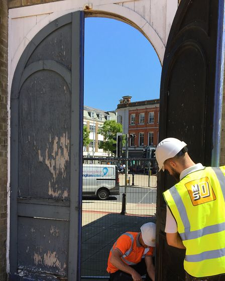 Contractors from MS Oakes Ltd remove the concourse doors at Lowestoft Station. Picture: East Suffolk
