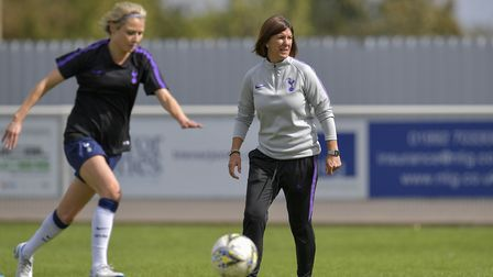 Tottenham Hotspur Women's manager Karen Hills watches on before a match (pic: Wu's Photography).
