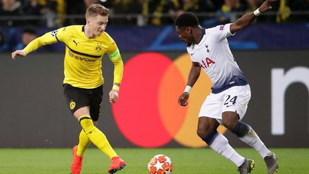 Borussia Dortmund's Marco Reus (left) and Tottenham Hotspur's Serge Aurier battle for the ball earli