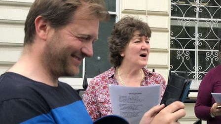 Richard Ratcliffe phones Gabriella during the singing for Nazanin outside of the embassy. Picture: F