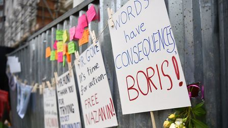 Placards outside the Iranian Embassy in London, where Richard Ratcliffe, the husband of detained Naz