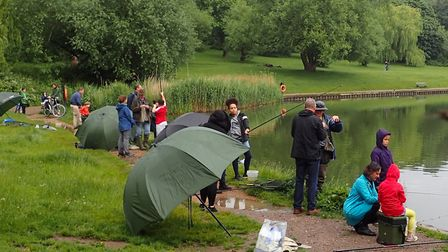 Children from Brookfield Primary School on the bank of the Model Boating Pond on Hampstead Heath, as