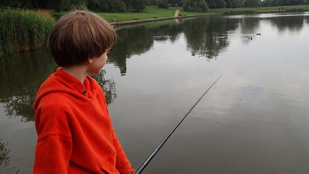 A child casts his first line during fishing tuition from the Hampstead and Highgate Angling Society