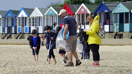 People taking part in the Adnams beach clean. Picture: Adnams