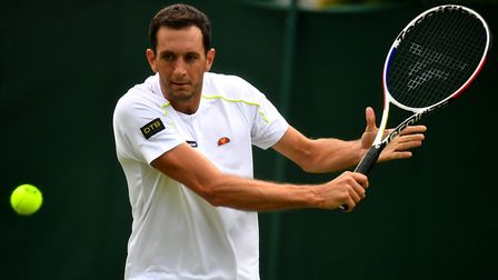 James Ward in action against Nikoloz Basilashvili on day two of the Wimbledon Championships at the A