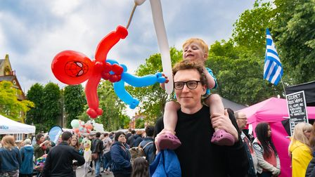 Families enjoy the balloon making at Fair in the Square. Picture: Siorna Ashby