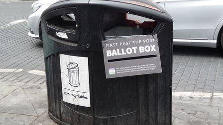 A litter bin turned into a first past the post ballot box during the Make Votes Matter campaign in D