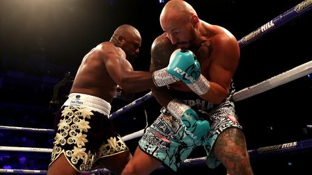 Derek Chisora (left) in action against Artur Szpilka (right) in the heavywight fight at the O2 Arena