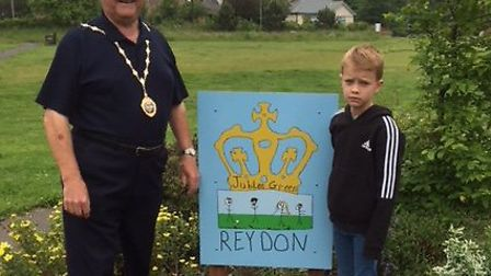 Chairman of Reydon Parish Council Barrie Remblance and Guy Barber unveil the new signs. Picture: Cou