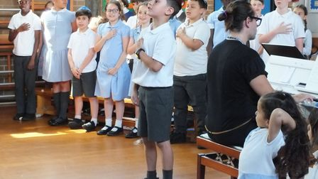 Pupils singing songs at Simon Marks Primary School's concert.