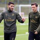 Arsenal's Sead Kolasinac (left) and Mesut Ozil. Kolasinac fought off two men wielding knives after h
