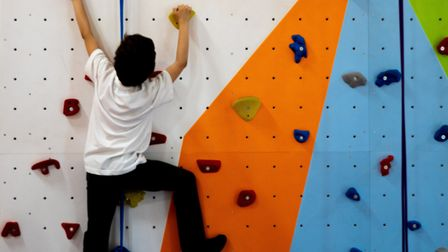 A child on the school's new climbing wall. Picture: Joshua Thurston