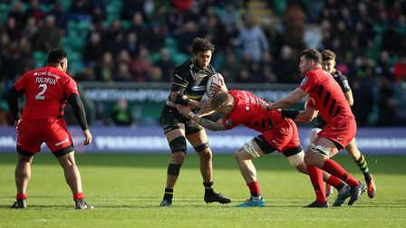 Northampton Saints Lewis Ludlam is tackled by Saracens Dom Day during the Premiership Rugby Cup Fina