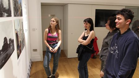 Photography students Cecily Piesold , Flora Jones , Cyrus Marks , Nancy Gonzalez looking at the disp