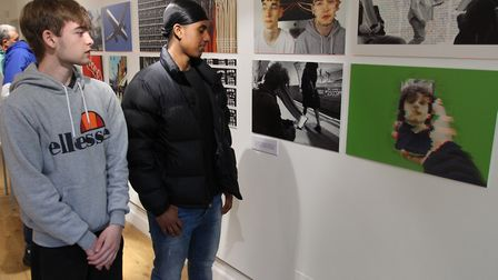 Ben Rago and Sam Gwinner from Fortismere School look at some of the work before the exhibition opens