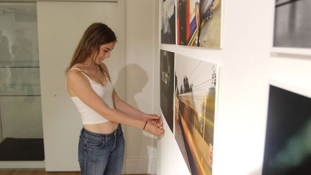 Sylvie Hosking putting up one of her photos at the Peltz Gallery. Picture: Guy Holden