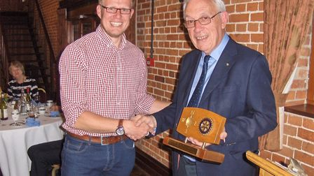 Julian Claxton being presented with the award by Lowestoft Rotarian John Hemming. Picture: Rotary Cl