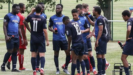 Wingate & Finchley players have a water break during a match against Hemel Hempstead Town in the Spe