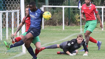 Wingate & Finchley are unable to force the ball home against Chalford St Peter (pic: Martin Addison)
