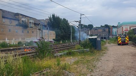 A grass bank next to a train line near Finchley Road is on fire. Picture: Camden Police