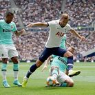 Tottenham Hotspur's Harry Kane (front) and Inter Milan's Milan Skriniar battle for the ball during t