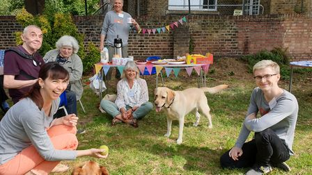 Labrador Themba and terrier mix Chippie with volunteers and members of Pets Against Loneliness. Pict