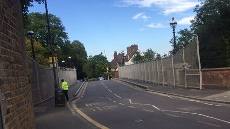 The new fencing at Archway Bridge, which also has security workers. Picture: @Block100AFC