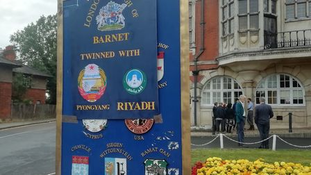 Protesters draped a banner over a sign at Barnet Council, comparing the authority to North Korea and