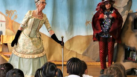 Benthal Primary School kids captivated by the queen and dragon played by Heather Qualtrough and Shar