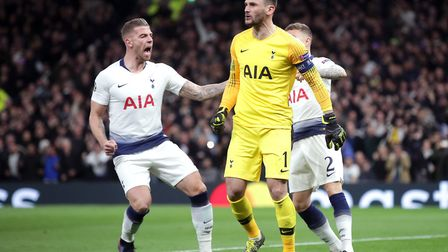 Spurs goalkeeper Hugo Lloris is congratulated by Toby Alderweireld (left) after saving a penalty fro