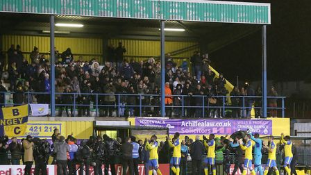 Haringey Borough players applaud the fans at the end of the FA Cup first round match against AFC Wim