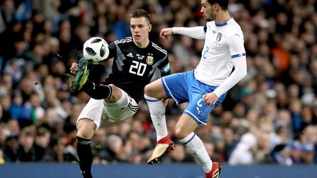 Argentina's Giovani Lo Celso (left) and Italy's Mattia De Sciglio battle for the ball at the Etihad