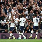 Tottenham Hotspur's Harry Kane (left) celebrates scoring his side's second goal of the game against