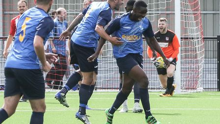 Olumide Oluwatimilehin celebrates scoring for Wingate & Finchley at Bowers & Pitsea (pic: Martin Add