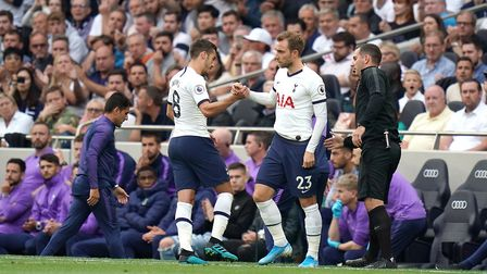 Tottenham Hotspur's Harry Winks (left) is substituted off the pitch for Christian Eriksen (right) du